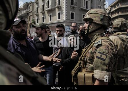 Tripoli, Lebanon, 28 April 2020. People shout at soldiers as riots broke out following the death of a protestor shot by the army during protests triggered by economic collapse the previous night. Elizabeth Fitt Credit: Elizabeth Fitt/Alamy Live News - Stock Photo