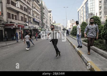 Tripoli, Lebanon, 28 April 2020. Riots broke out following the death of a protestor shot by the army during protests the previous night. Elizabeth Fitt Credit: Elizabeth Fitt/Alamy Live News - Stock Photo