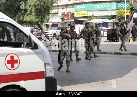 Tripoli, Lebanon, 28 April 2020. Soldier firing rubber bullets at people during riots that broke out following the death of a protestor shot by the army during protests the previous night. Elizabeth Fitt Credit: Elizabeth Fitt/Alamy Live News - Stock Photo