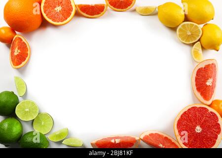 Fresh mixed citrus fruit including   lemons, limes, grapefruits, oranges and tangerines with slices, isolated on white background, top view - Stock Photo