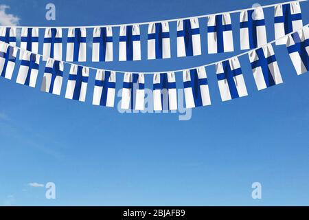 Finland flag festive bunting hanging against a blue sky. 3D Render - Stock Photo