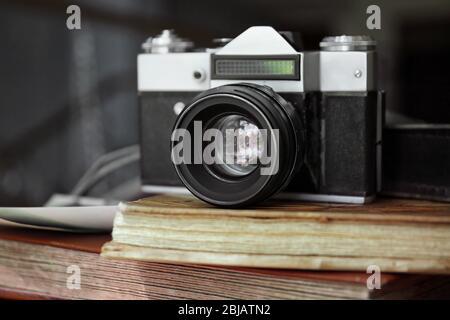 Vintage camera on photo albums - Stock Photo