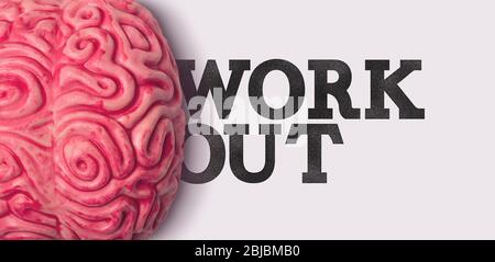 Work out word next to a human brain model - Stock Photo