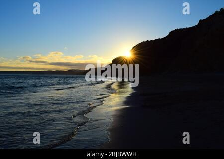 A Beach at Sunset in the Algarve