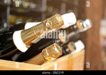 Bottles of different wine in wooden box, closeup - Stock Photo