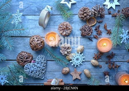 Christmas composition of natural decor on wooden background - Stock Photo