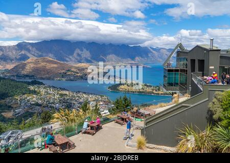 View over the city and Lake Wakatipu from the top of the Skyline Gondola, Bob's Peak, Queenstown, New Zealand - Stock Photo