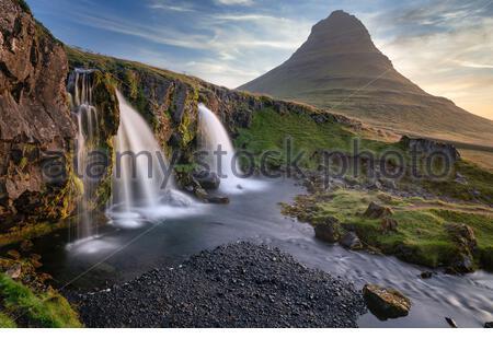 Iceland : Kirkjufell mountain and Kirkjufellfoss (falls) in Snæfellsnes peninsula, near the town of Grundarfjörður - Stock Photo