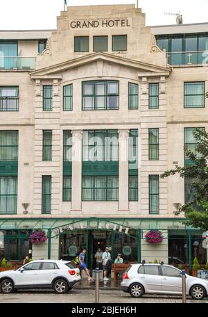 SWANSEA, WALES - JULY 2018: Exterior view of the Grand Hotel next to the railway station in Swansea city centre. - Stock Photo
