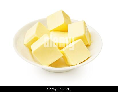 Butter pieces in white bowl isolated. Butter cubes. - Stock Photo