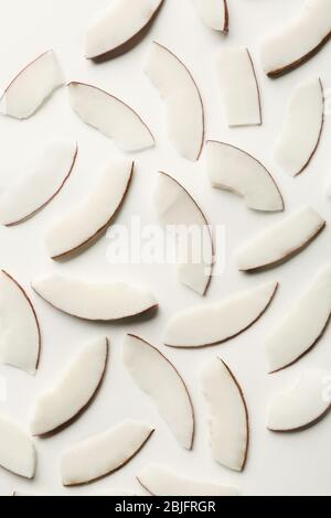 Coconut pieces on white background - Stock Photo