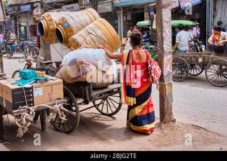 New Delhi / India - September 19, 2019: Indian woman in colorful sari at Chandni Chowk, a traditional busy shopping area in Old Delhi, India
