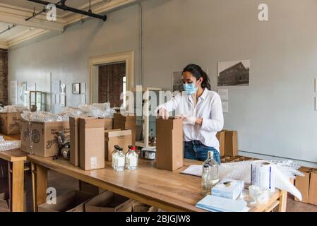 Brooklyn, New York, USA - April 24, 2020: Bottles of hand sanitizer being shipped by Kings County Distillery. The Distillery that usually produces whi - Stock Photo