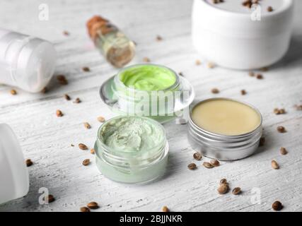 Cosmetics with hemp extract on white wooden background - Stock Photo