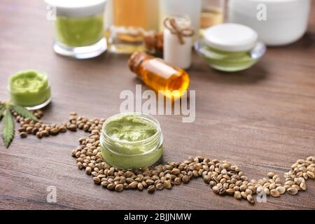 Cosmetics with hemp extract on wooden table - Stock Photo