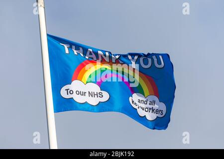 Ashford, Kent, UK. 30th Apr, 2020. On the day people come and show appreciation to the NHS for their outstanding efforts during the Coronavirus pandemic, a group of villagers from Hamstreet near Ashford in Kent raised a flag saying thank you to our NHS and keyworkers. ©Paul Lawrenson 2020, Photo Credit: Paul Lawrenson/Alamy Live News - Stock Photo