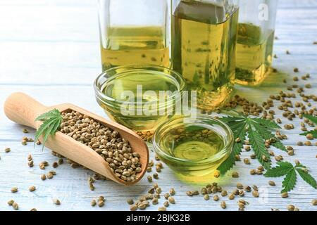 Composition with hemp oil on table - Stock Photo
