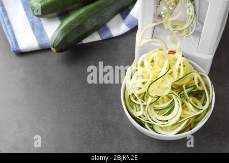 Making spaghetti squash on kitchen table - Stock Photo