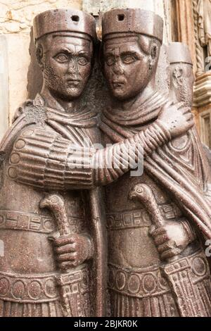 Statue of the four tetrarchs outside St Mark´s Basilica in the Piazza San Marco, Venice, Italy. - Stock Photo