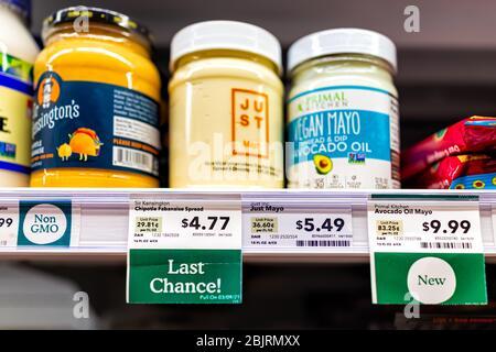 Reston, USA - April 27, 2020: Northern Virginia Whole Foods Amazon grocery store shop interior shelf packaged retail display of vegan plant-based natu - Stock Photo
