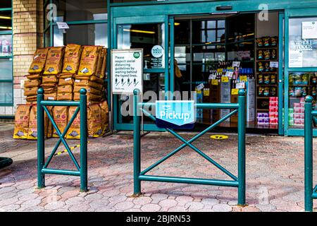 Reston, USA - April 27, 2020: Northern Virginia Whole Foods Amazon grocery store sign for social distancing by entrance with prime food online deliver - Stock Photo