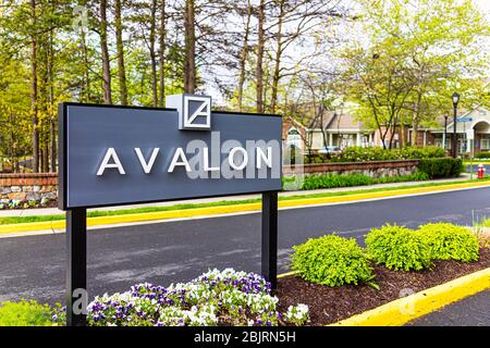 Reston, USA - April 27, 2020: Northern Virginia road sign entrance closeup near metro in town center with Avalon text for apartment complex - Stock Photo