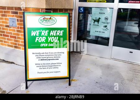 Herndon, USA - April 27, 2020: Sprouts Farmers Market sign for grocery store entrance for social distancing delivery during coronavirus Covid-19 epide - Stock Photo