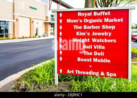 Herndon, USA - April 27, 2020: Virginia Fairfax County building exterior sign in strip mall for Mom's Organic Market store shop, buffet restaurant, ba - Stock Photo