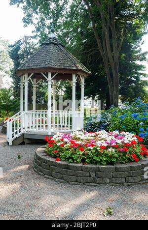 Gazebo and flower planter in South Park on South Tacoma Way, Tacoma, Washington. - Stock Photo