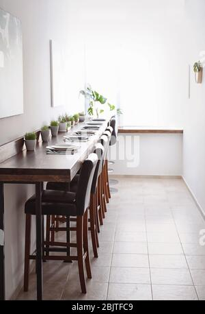 Table setting in vegetarian cafe - Stock Photo