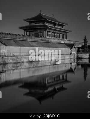The Gate of Divine Might, North exit gate of the Forbidden City Palace Museum, reflecting in the water moat in Beijing, China