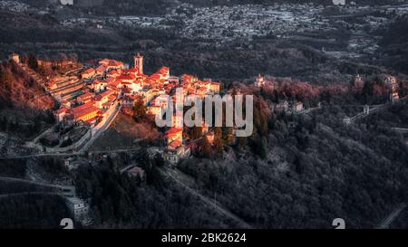 small ancient village of Sacred Mount of Varese illuminated by the setting sun - Stock Photo