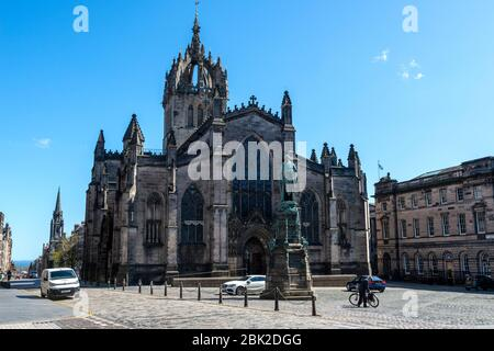 St Giles Cathedral with Statue of Walter Francis Montagu Douglas Scott in foreground viewed from the High Street in Edinburgh Old Town, Scotland, UK - Stock Photo