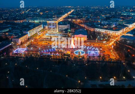 Gomel, Belarus - January 13, 2020: Main Christmas Tree And Festive Illumination On Lenin Square In Homel. New Year In Belarus. Aerial Night View.