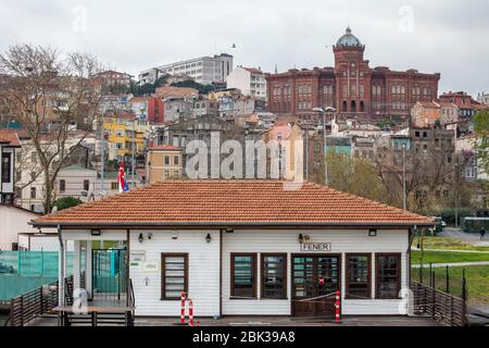 View of Fener Pier with Phanar Greek Orthodox College on the background, Balat, Fatih, Istanbul, Turkey. - Stock Photo