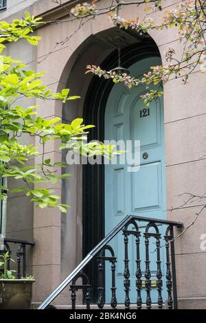 A well-kept brownstone in Murray Hill feature a blue door, New York City, USA - Stock Photo