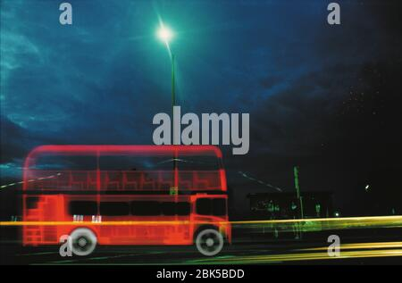 Double decker bus in the city, coloured X-ray. - Stock Photo