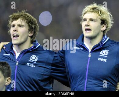 Brothers Jonny Gray & Richie Gray sing the national anthem before the  Autumn Test between Scotland and New Zealand at BT Murrayfield, Edinburgh. - Stock Photo
