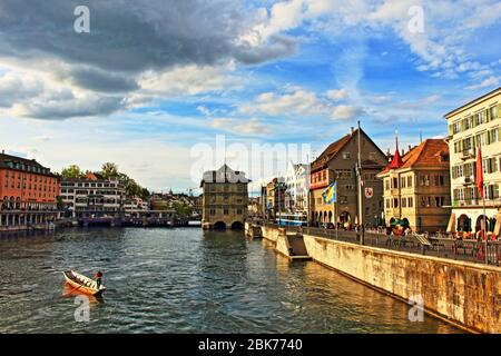 View of central Altstadt (Old Town), with Limmat River from Münsterbrücke to Rathausbrücke with the Rathaus -Town Hall of Zürich, Switzerland-May 2017 - Stock Photo
