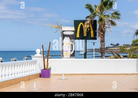 Restaurant and beach bar closed during the covid 19 lockdown in the tourist resort area of Costa Adeje, Tenerife, Canary Islands, Spain - Stock Photo