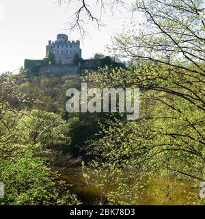 Burg (castle) Pyrmont on a hill surrounded by green trees on a spring day in Germany. - Stock Photo