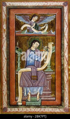 Saint Matthew the Apostle writing the Gospel accompanied by the angel (symbol of the tetramorph). Miniature, 12th century. Conde Museum. Chateau of Chantilly. France. - Stock Photo