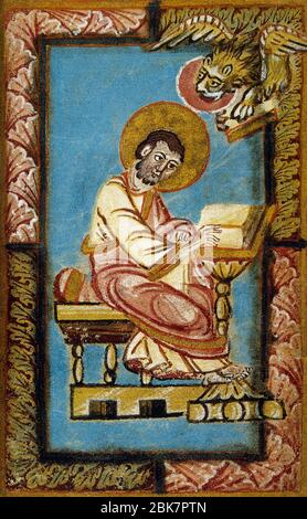 Saint Mark the Evangelist writing the second Gospel, accompanied by the winged lion (symbol of the tetramorph). Miniature, 11th century. Conde Museum, Chateau of Chantilly. France. - Stock Photo
