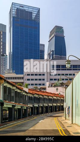 Singapore downtown skyscrapers viewed from Chinatown with traditional colonial shop houses archway arcade in the foreground - Stock Photo