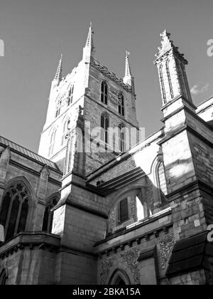 Southwark Cathedral, located on the south bank of the Thames River, London, UK, in the late afternoon on a clear sunny day, photographed in Monochrome