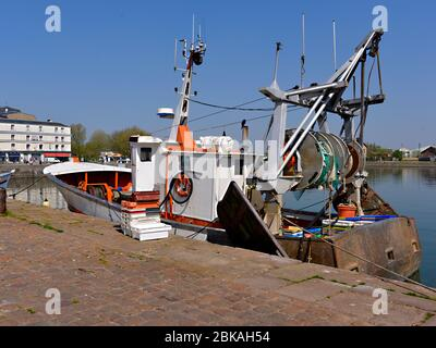 Fishing trawler in the port of Honfleur, commune in the Calvados department in the lower Normandy region in northwestern France - Stock Photo