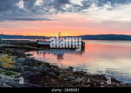mv loch tarbert car ferry at sunset, lochranza, arran - Stock Photo