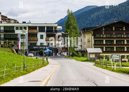 Hintertux, Austria - August 10, 2019: View of Nennerhof Apartments and Badhotel Kirchler - Stock Photo