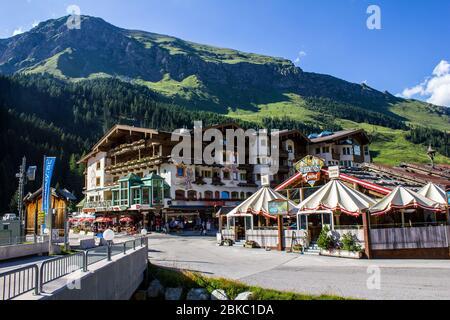 Tux, Austria - August 9, 2019: View of Neuhintertux Hotel and Hohenhaus Tenne Bar on a Summer Day - Stock Photo