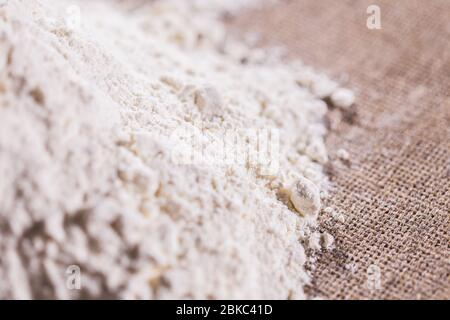 Heap of dry flour on textile. Cooking flour products concept. - Stock Photo